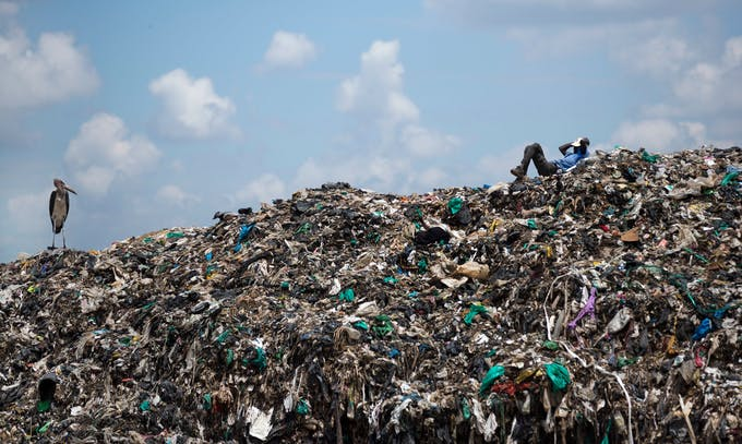 A mountain of garbage and plastic bags at a dump in Nairobi, Kenya. Ben Curtis/Associated Press