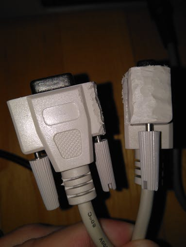 I'm using standard SUB-D-9 connectors. The connectors are too wide to connect two of them in the C64. So I had to cut off some of the plastic housing.