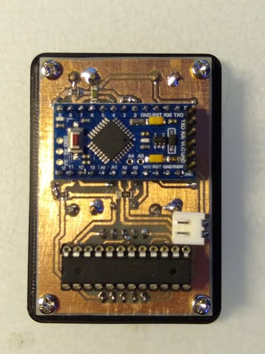 Arduino Pro Mini and MAX7219 IC are mounted on the back of the board