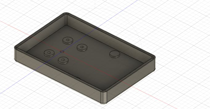 Inside top casing. Mounting holes for GPS and solder board.