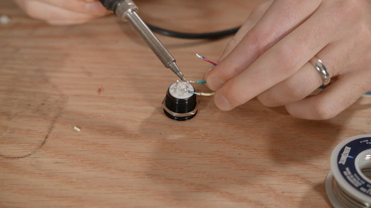 Soldering the button