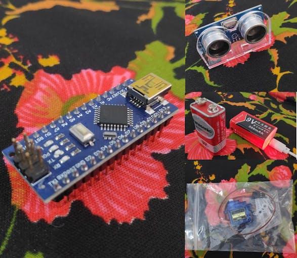 Arduino project parts including ultrasonic sensor, servo motor and the Nano itself
