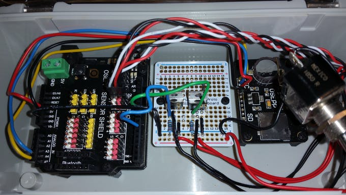 This is the nearly finished box. I left the switch out of its hole to get a good look at the Perma-Proto board.