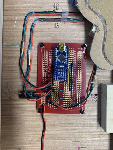 circuit layout (I glued rubber standoffs to the back of the painting to secure the perf-board)