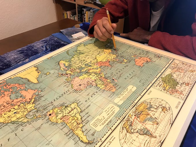 You can then glue your map in place and pierce the holes gently (with a pen for example).