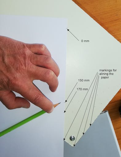 Mark the centre (0 mm) and the aligning marks along the sides of the ceiling plate, use a sheet of paper with marks at 0 mm and at 150 mm and 170 mm for the marks for the holes.