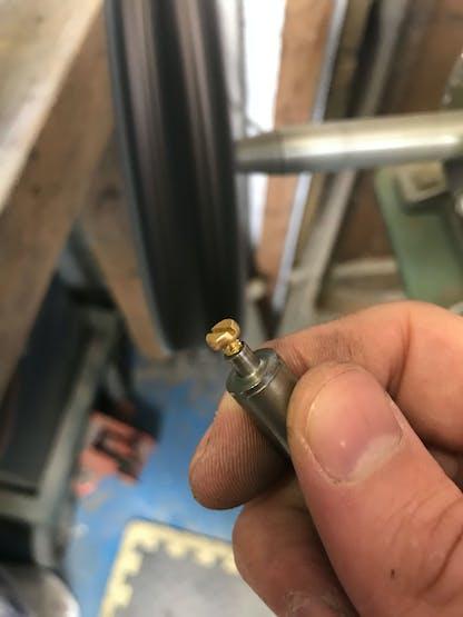 A custom made M3 screw polishing tool :-)
