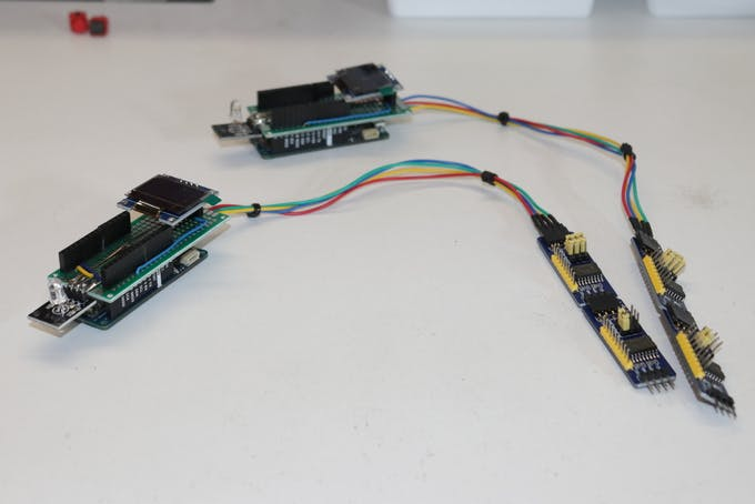 The two Arduino MKR1010 with the shields assembled and the Rows/Colums connectors (yellow) of the GPIO expandes before the installation on the chessboard.