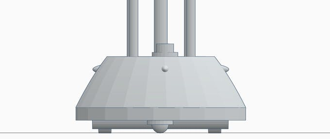 Base fitted with upper chasis, the four small projecting structure are PIR sensors