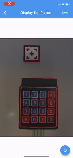 processed image of the keypad. Highlighted in red the buttons boundary