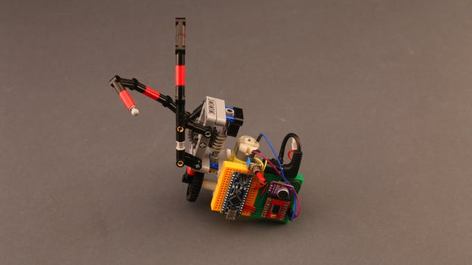 Fig. D - Zipline robot with Arduino board and microphone