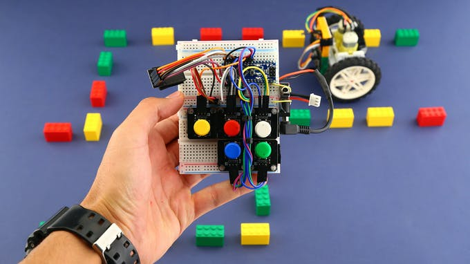 Fig. B - Remote tangible coding console and the mobile robot