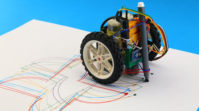 Fig. E – Drawing with tangible coding robot