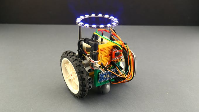 Fig. F – Tangible coding robot with RGB LEDs