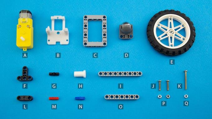Fig. I - Lego Technic components, DC gear motors and custom 3D printed parts