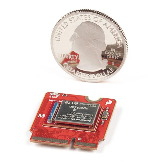 Artemis processor MicroMod next to a US quarter dollar.
