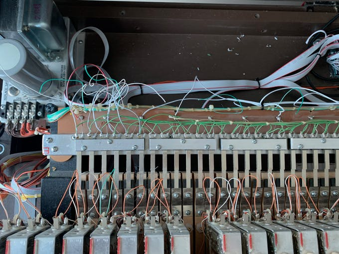 Matrixed design: At left the 6 row leads are shown soldered to the respective contacts for the switches. Middle and right are shown the column leads soldered to the ends of the diodes.