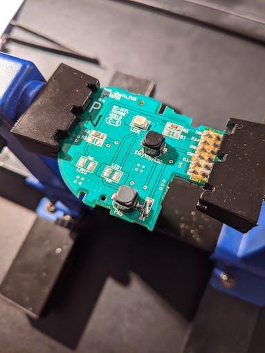 Added button (bottom) on car button module circuit board.