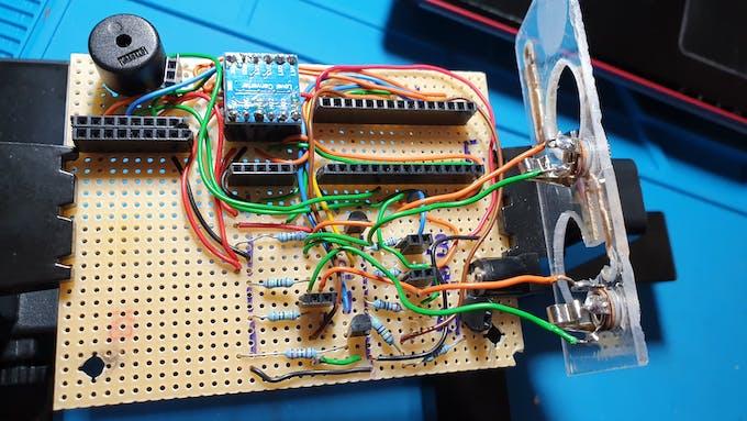 Added piezo speaker(upper left corner) and voltage divider (lower left resistors).