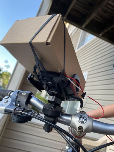 Figure 3: Shows how Cardboard box is attached to bike.