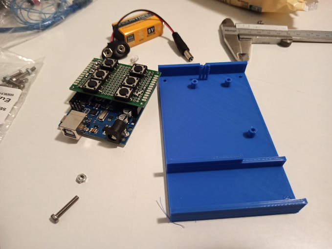 Electronic assembly + bottom part of the enclosure. It possible to see the 3 cylindrical post are meant to host the screw for securing the board to the enclosure. 3 mini-post are used to align the led-emitter leads in front of the hole
