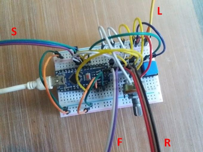 Fig. 8 – The assembly: S – light sensor module; L – laser module; F – flash light; R – remote control
