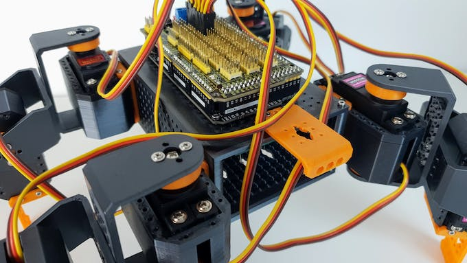 Quadruped robot actuated by 8 servo motors and controlled by an Arduino MEGA board