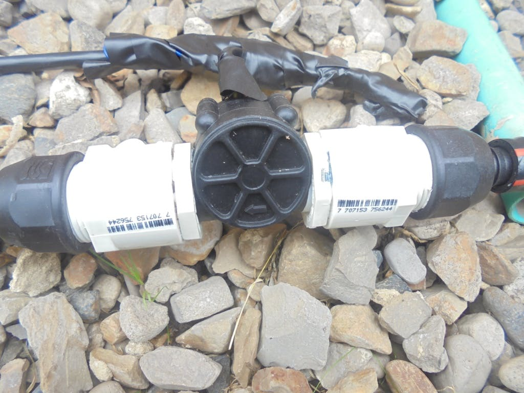 Flow Meter and accessories downstream of the solenoid valve