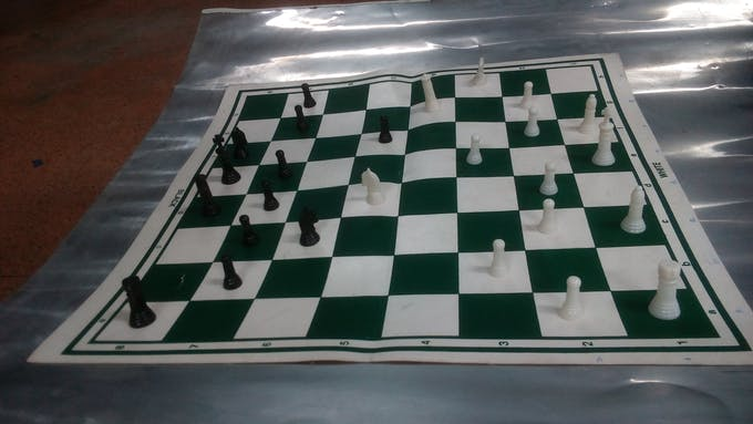 Chess Board with coins.
