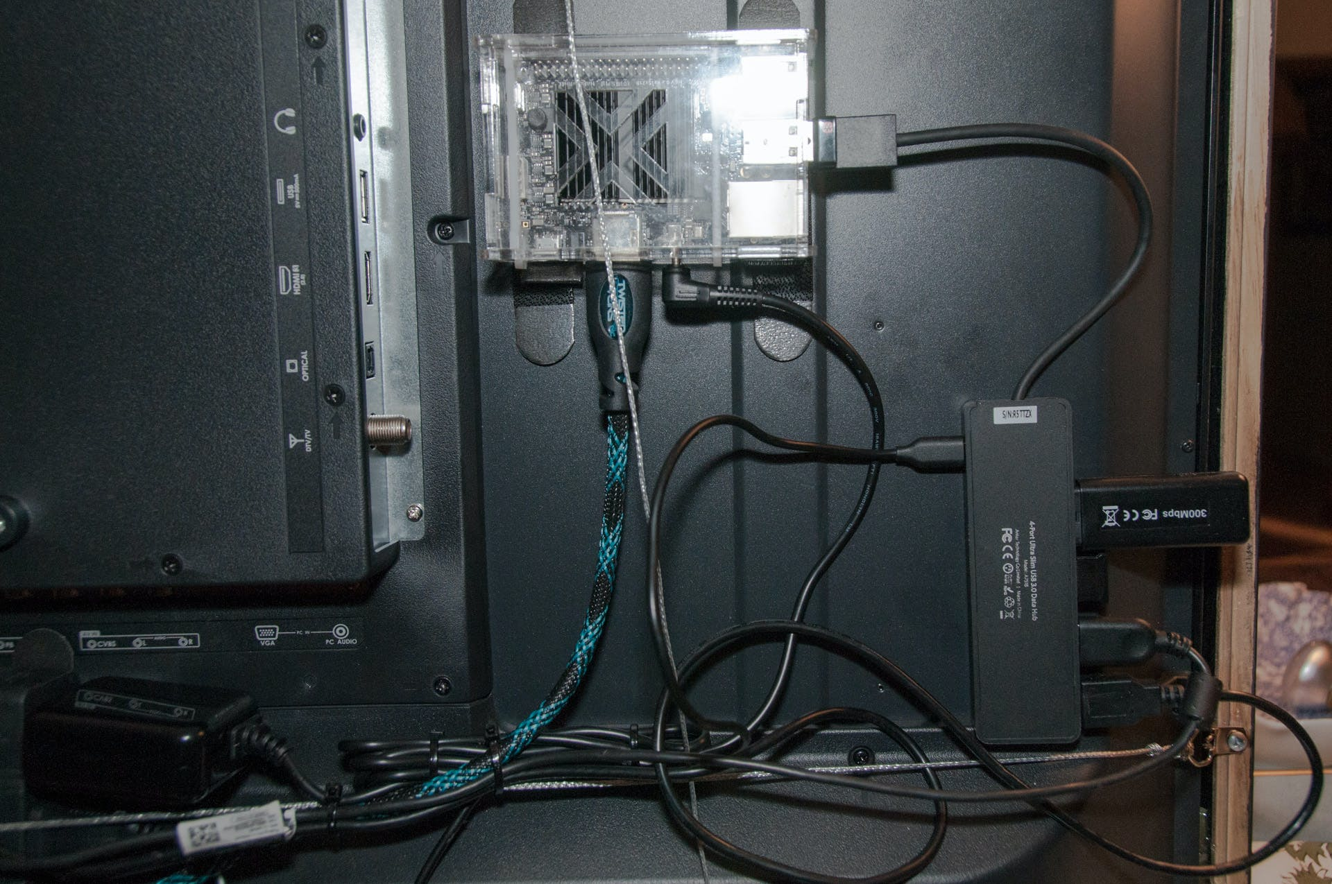 Used Command strips to held the Odroid C2 and USB hub to the TV. Later it can be removed without damaging the TV