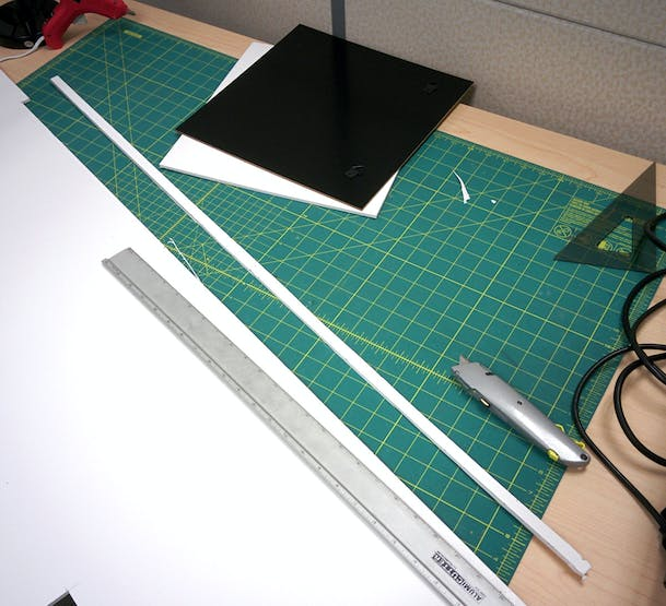 "You can use the frame's back to help cut a 12"" x 12"" square.  Then cut a nice even 0.5"" strip"