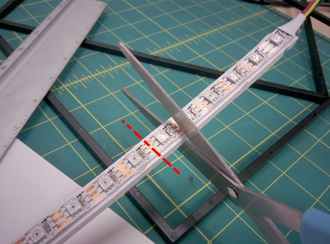 Cut through the copper pads. This doesn't damage the LEDs and allows you to solder new wires to the ends for later use.
