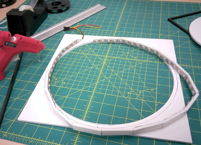 """gluing the ring in place.  Make sure the strip doesn't come closer than 1/4"""" from the outer edge of the square."""
