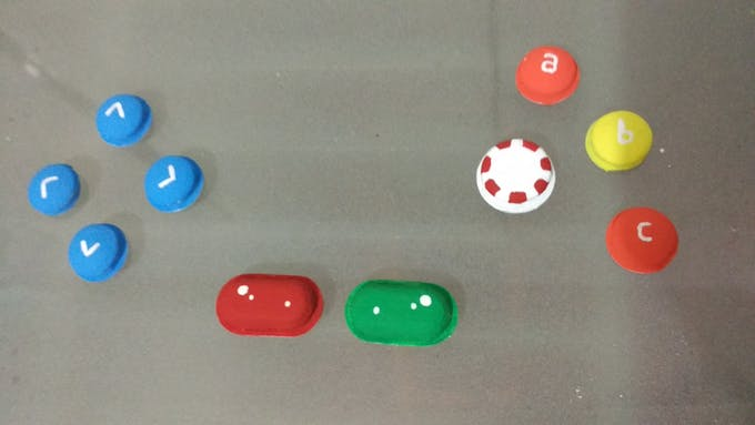 The buttons were hand painted to make them look like candy toppings