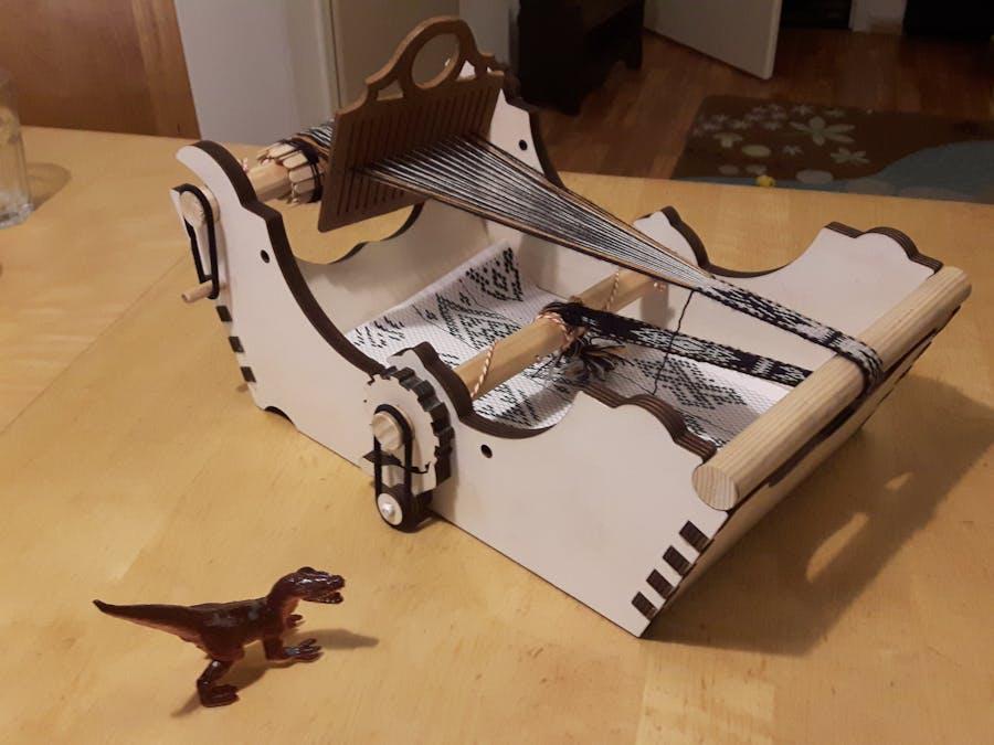 Laser cut plywood bandweaving loom