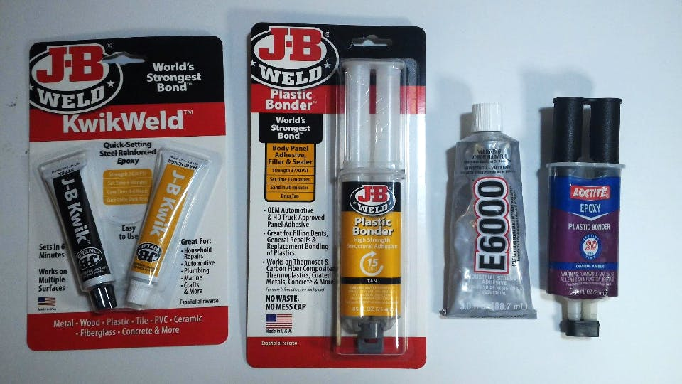 J-B Weld KwikWeld was the only adhesive that worked for us.