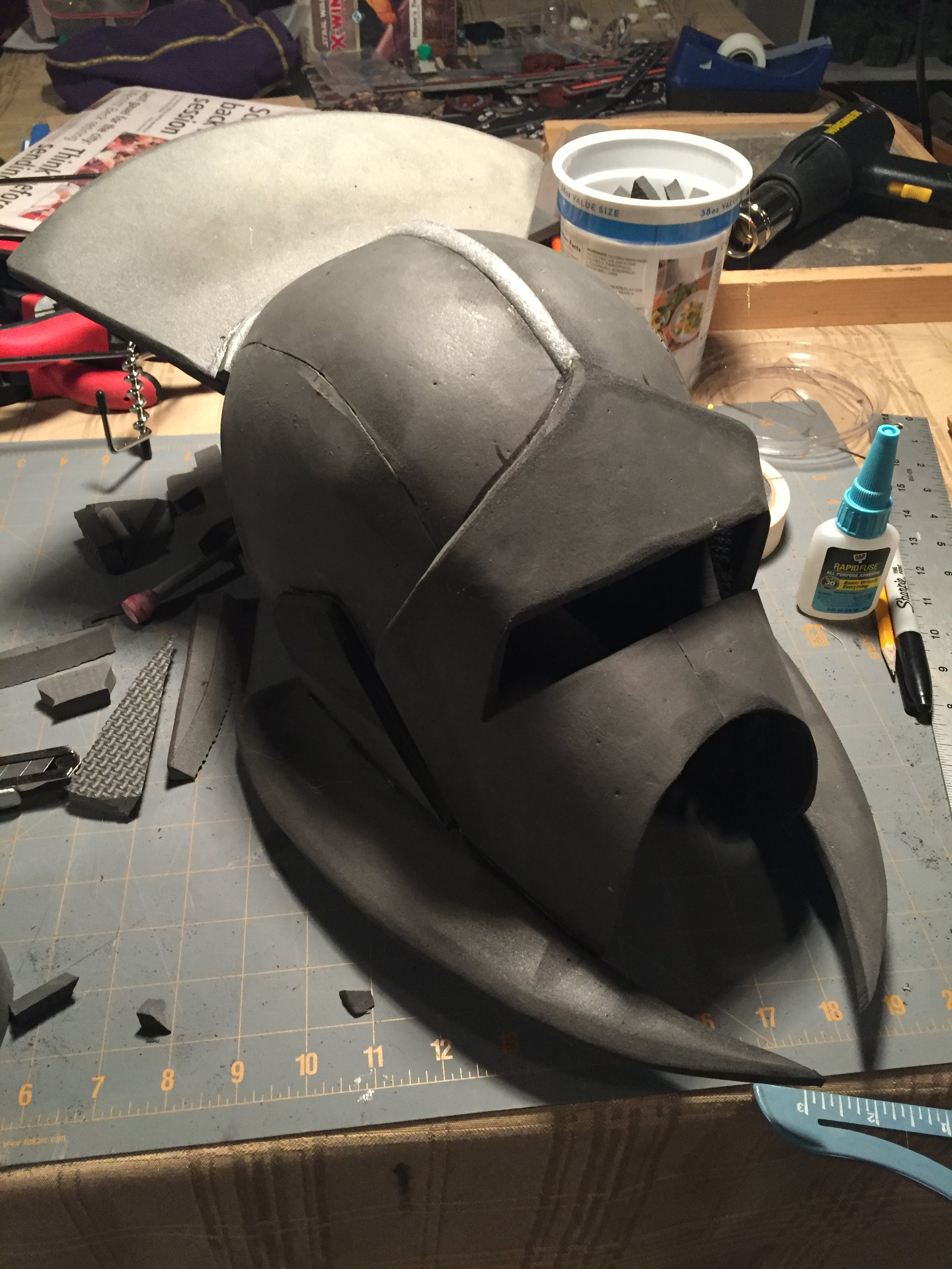 Jowl spikes added and the line on top of the helmet is just foam expansion bead cut in half.