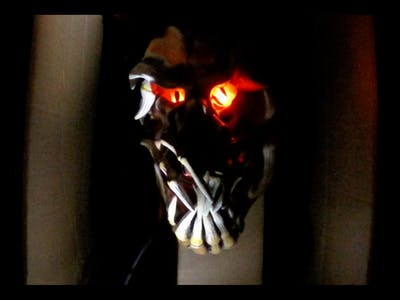 a motion activated light and sound installation to scare the trick or treaters