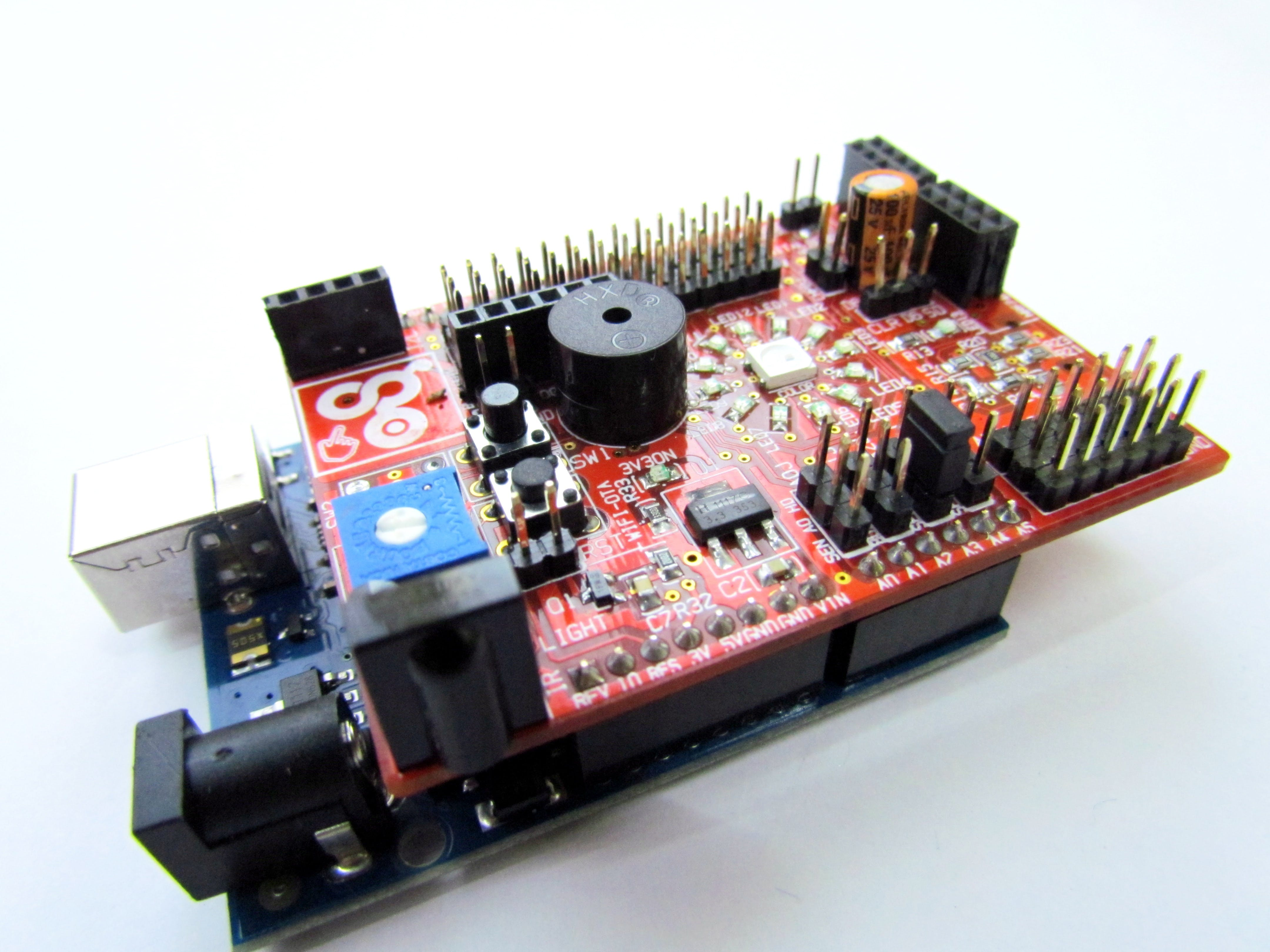 The potentiometer is already connected on the shield, but it has to be enabled using the 3 pin  Selection Jumper S E L 2.