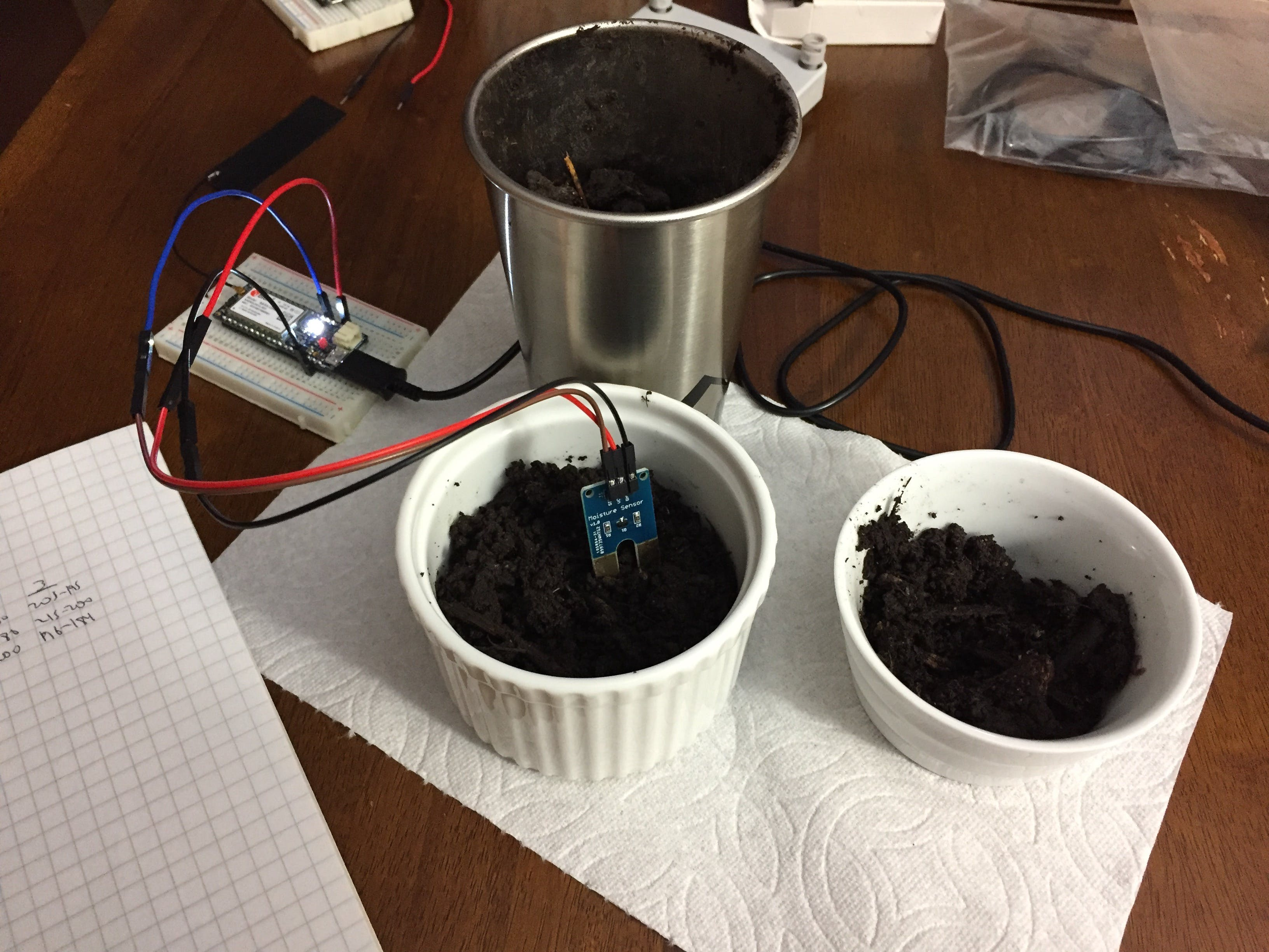 Running the moisture sensor in some test dirt to be sure it all works