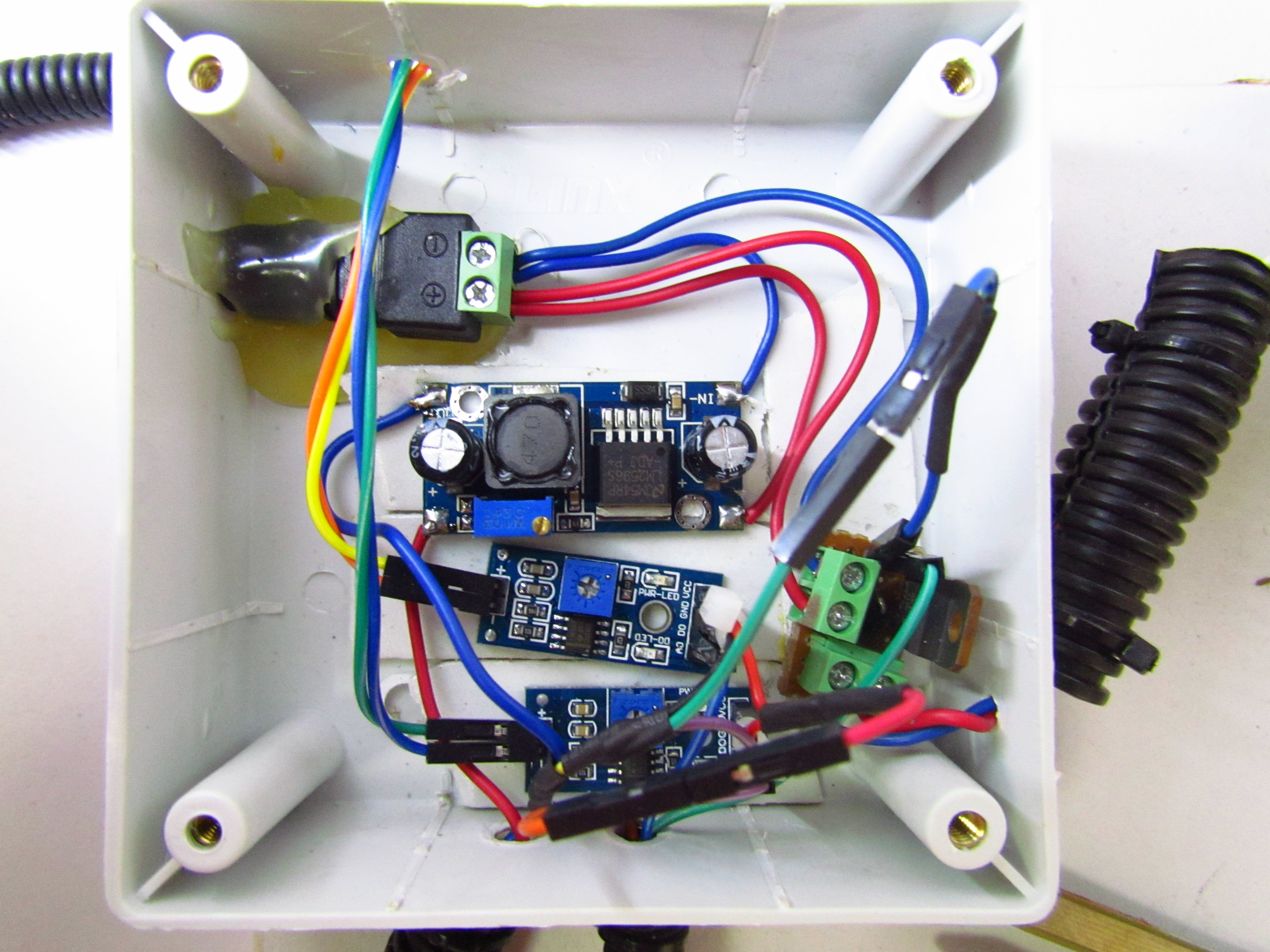 Buy a waterproof enclosure and wire the circuit according to the  circuit diagram.