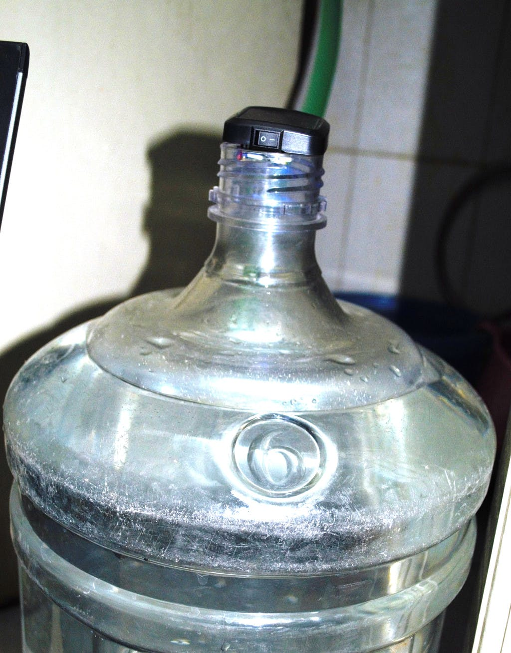 Sensor unit mounted on top of the tank (in this case, a can filled with water)