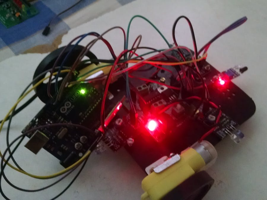 Robotic Car controlledover Bluetooth with Obstacle Avoidance