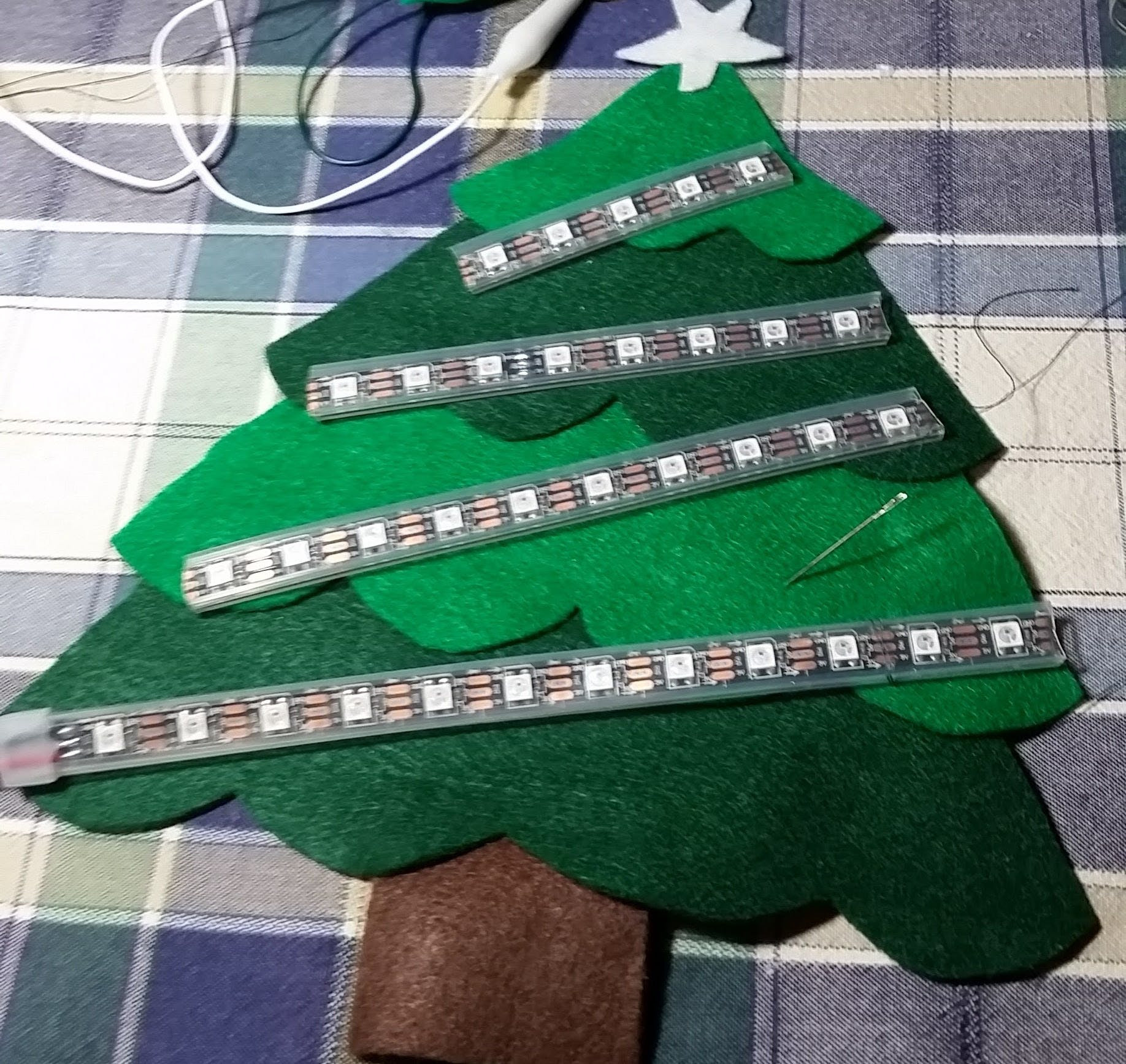 After hot-gluing the tree, I cut the NeoPixel strips to size.
