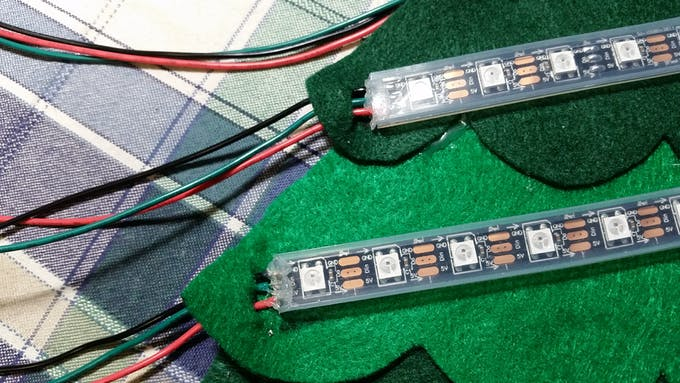 I soldered 5V (red), GND (black), and data (green) wires onto each strip.