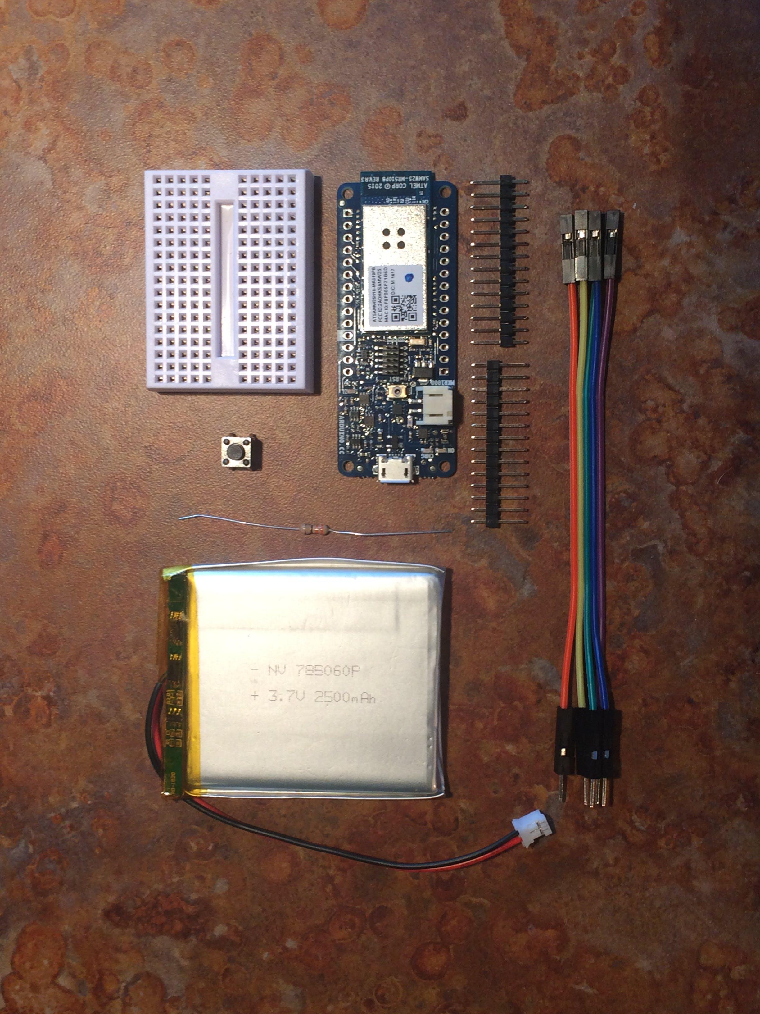 Arduino MKR1000 w/ header pins, push button, female-male jumpers, resistor LiPo battery, breadboard