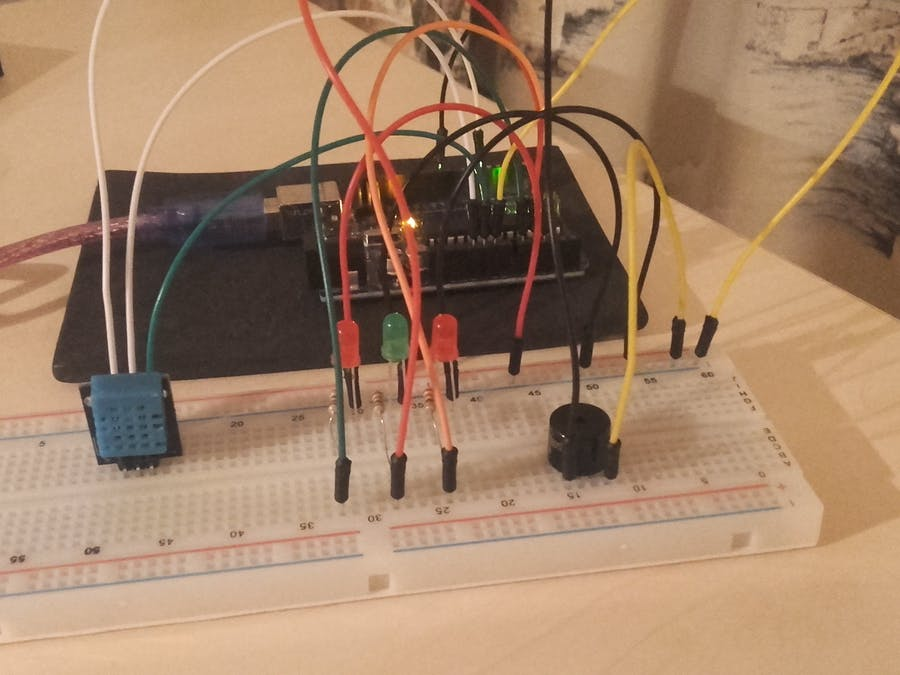 DHT11  Sensor with LEDs and a Piezo Speaker