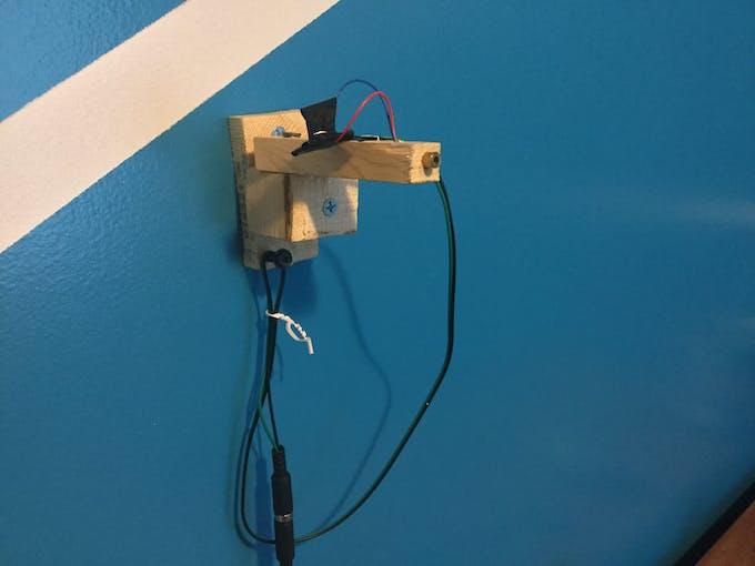 Laser pan/tilt bracket enables 360˚ rotation for aiming purposes.