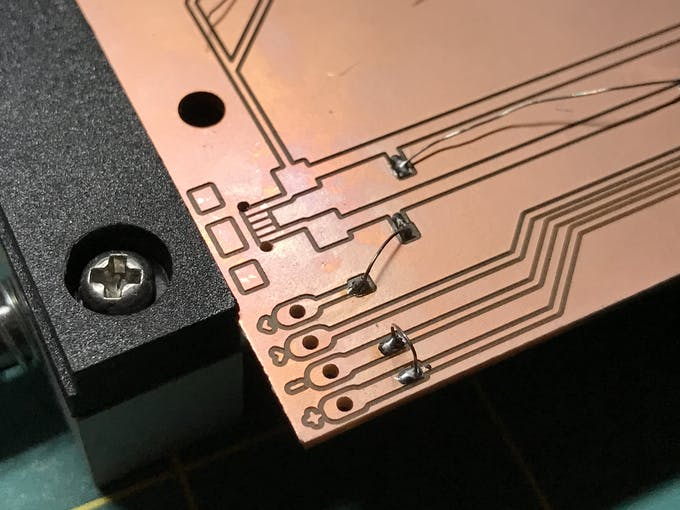 Solder the wire to the via pads on both side like this.