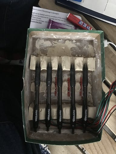 This is the clay mold that I used. The pens line up over the limit switch so when you place the pens there, the switches depress.